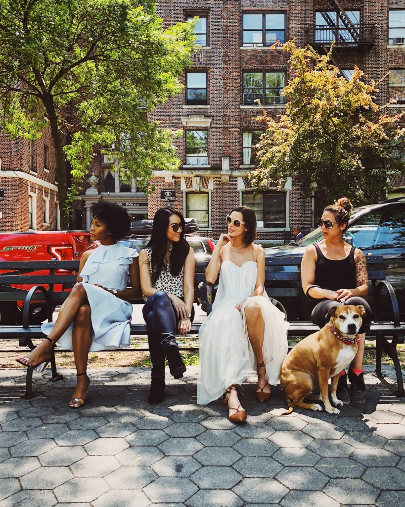 confident women sitting on a bench