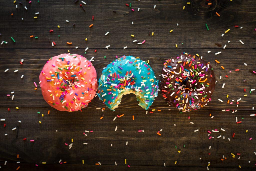 three sprinkle donuts