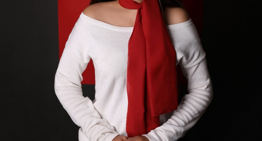woman wearing red scarf