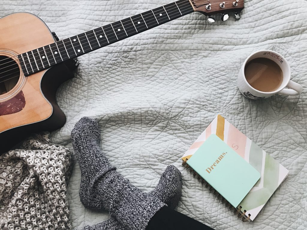 journal guitar and coffee