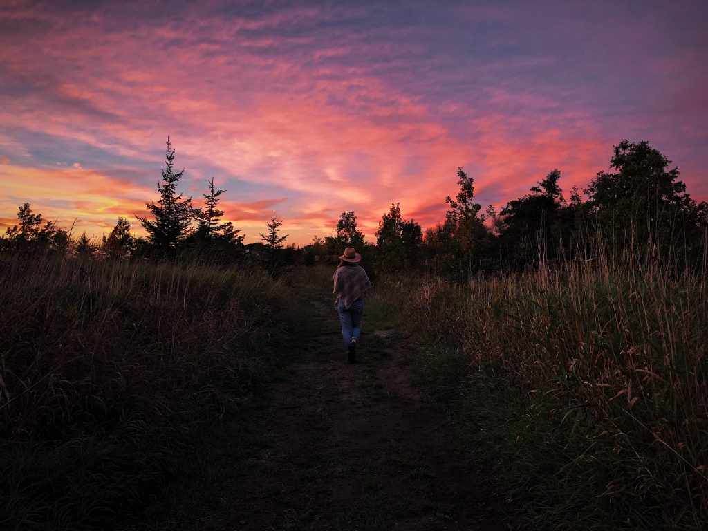 woman walking in nature at twilight