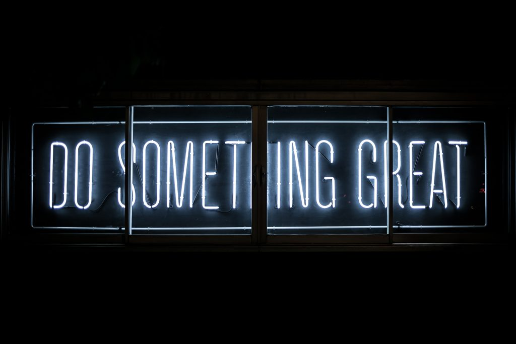 do something great neon sign - what motivates you
