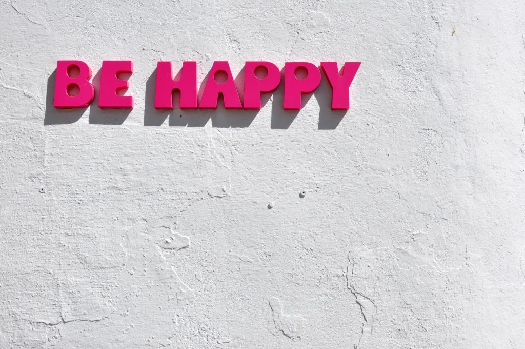 pink be happy sign - what motivates you