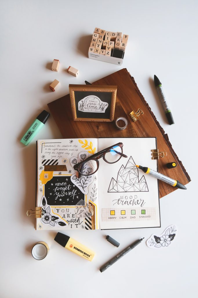 bullet journal with glasses