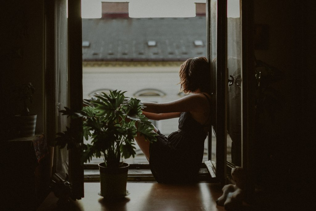 woman in window - limiting beliefs