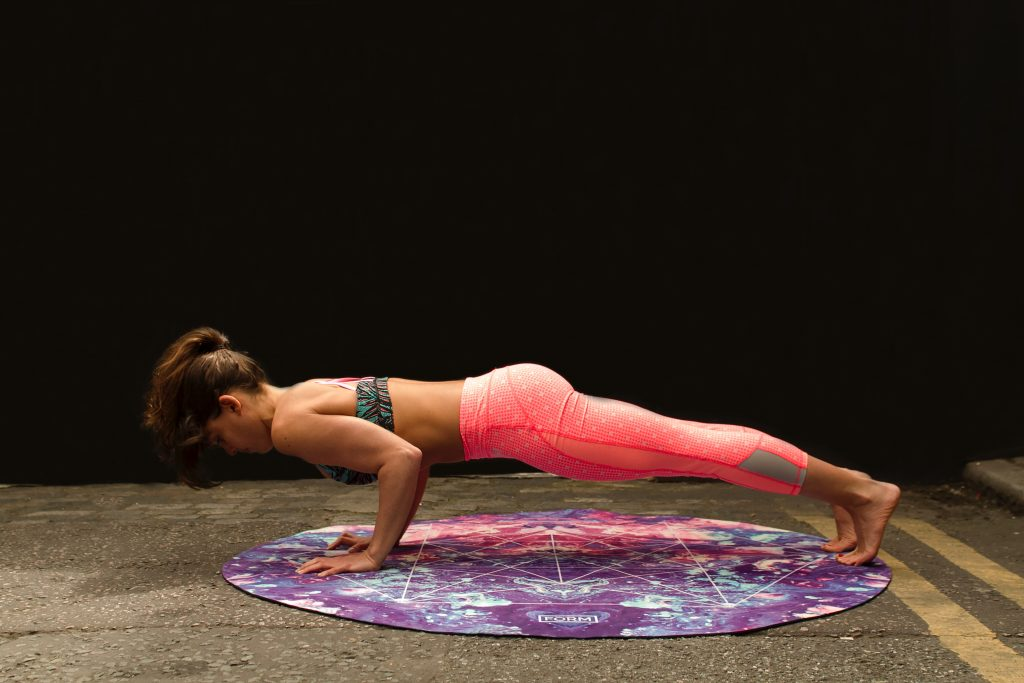 woman yoga pushup self-improvement