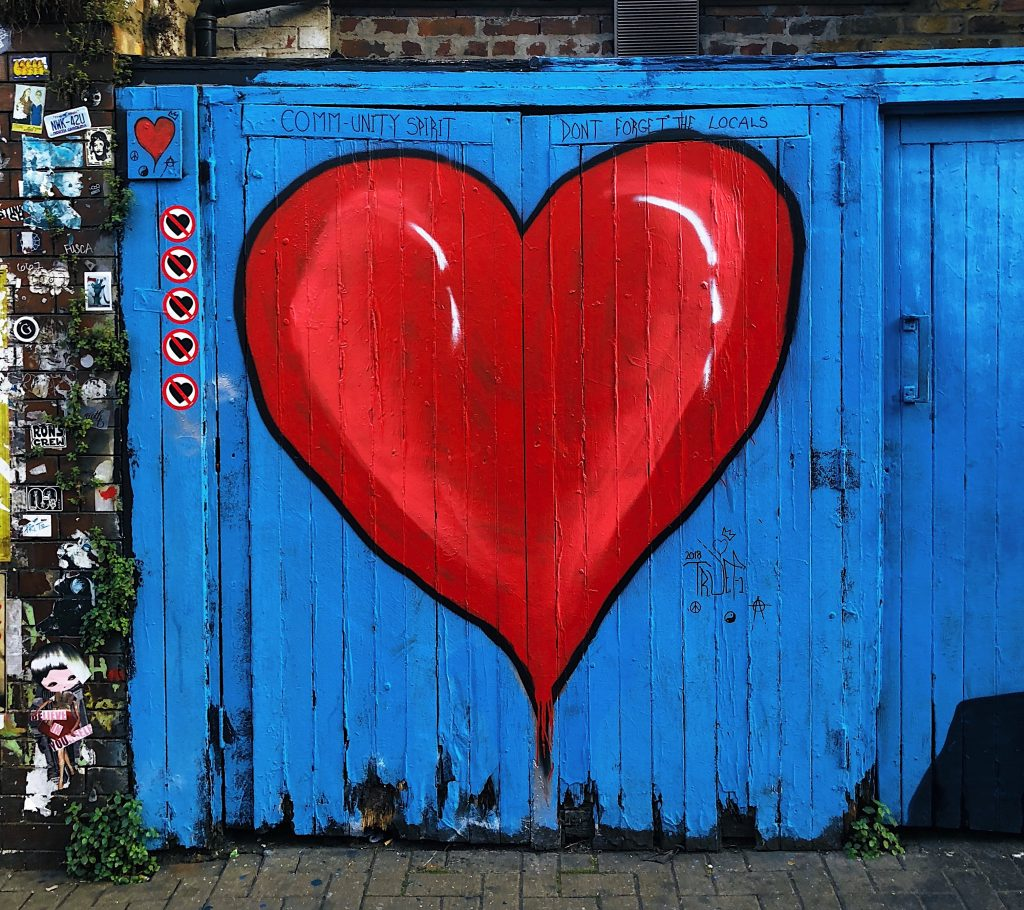 red and blue heart wooden gate